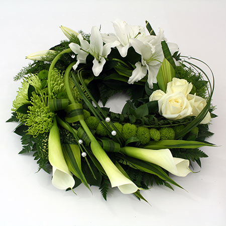 Wreath includes roses, lily & blooms Reference: SYM19